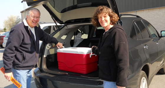 Volunteers help with Meals on Wheels